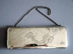 STERLING wrist purse engraved and decorated. it is 7 inches wide and 2-1/2 inches across, and is dated 6-14-22