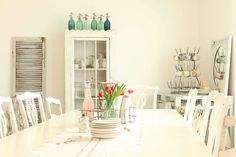 seltzer bottle collection, white dining room