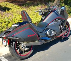 Honda NM4 Vultus with black & carbon Moriwaki exhaust.