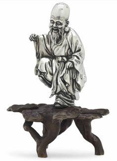 A silver model of Jurojin (14,3 cm) Meiji period (late 19th century), signed…