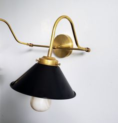 Love all the curves on the Double Valmont black and brass Sconce by Sazerac Stitches! It looks so perfect with our light marble patterned light bulb. It would be a modern update to a study or office decor. Brass Sconce, Sconces, Desk Light, Marble Pattern, Modern Lighting, Desk Lamp, Office Decor, Light Fixtures, Light Bulb