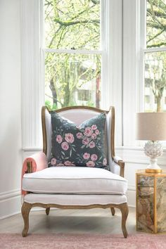 Classic French frame with an updated twist in chic neutral upholstery to compliment any color scheme. Both elegant in style and inviting with comfort the Eve chair features foam and down cushioning, hand carved oak frame and one down filled accent pillow. | Caitlin Wilson
