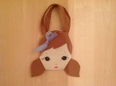 Doll face cotton and felt bag- Dorothy from the Wizard of Oz on Etsy, £10.00