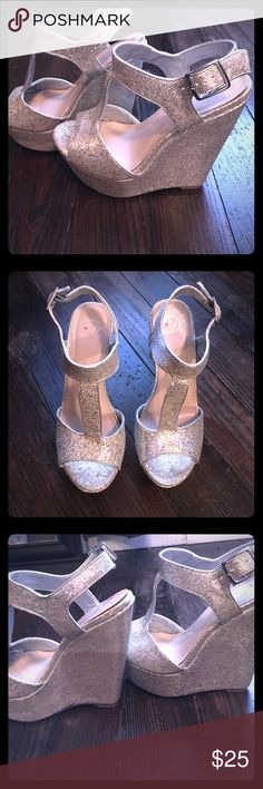 Silver glitter wedges, size 5.5 Silver glitter wedges, size 5.5-6 D heart brand. Worn for a couple weddings so still in good condition. D heart Shoes Wedges