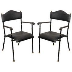 Pair of 1950's armchairs by Jacques Adnet
