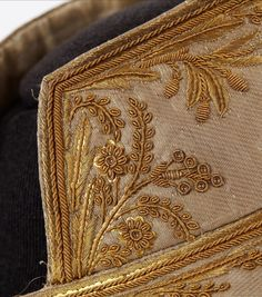 Collar of a coat with gold thread embroidery and sequins. Perfect S-ing....