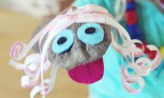 Sock puppet w/ felt & paper hair.
