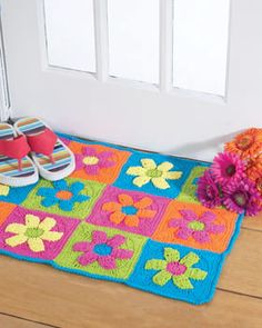 Crochet a funky flower rug with this free pattern.   This easy to make rug will add a burst of bright color and a fun, youthful touch to any room in your house.