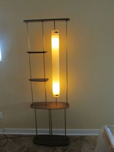 Mid-century lighted room dividing shelf unit.
