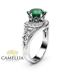 Stunning feminine and breathtaking! This natural emerald halo engagement ring is crafted in solid 14k white tone gold with a 2 ct round shaped natural emerald, beautiful shiny stone, full of luster and brilliance. Set into a gorgeous floral ring. The timeless and unique design of this filigree ring will make your engagement unforgettable.   SETTING #SKU: ANr-0001A Metal: 14K White Gold (Available Also in 14K Yellow Gold or 14K Rose Gold - No Extra Charge) Certificate: CJC (Camellia Jewelry…