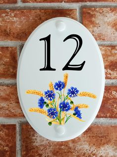 A range of pottery style house plaques feature prints of original artwork from our own sign artists. Hand cast in cultured marble these number plates are weatherproof outdoors. House Plaques, House Number Plaque, House Numbers, Floral Motif, Original Artwork, Decorative Plates, Pottery, Signs, Prints