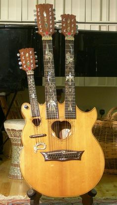 Triple Neck made for John Paul Jones by British Luthier Andy Manson. It has a mandolin, 12-string and 6-string neck. Andy Manson and his brother Hugh Manson are world famous luthiers who have built guitars over decades for some of the best guitarists in the world. His brother Hugh specializes in electric guitars and works via his company Manson Guitar Works in Exeter, Great Britain. Andy Manson now lives in Espinho, Portugal .