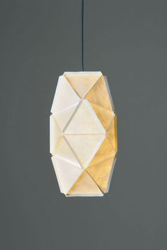 An abstract lighting sculpture series that are constructed out of pieces of Tyvek that are cut into triangles and assembled into their hanging forms.