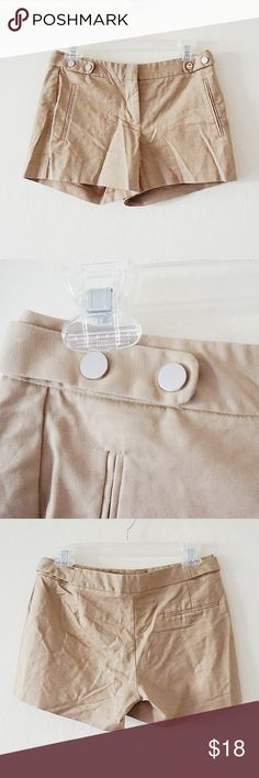 Zara Basic Tan Shorts with Metal Buttons Zara Basic Tan Shorts with Metal Buttons. Size Small. A bit wrinkled in the picture but a great pair of shorts. Excellent condition. No rips or stains. Have metallatic buttons near the pockets.  Waist flatlay 14.5in Rise 8.5in Inseam 3.5in Oz 8 #151  Offers Welcome Ships 1-3 days Bundle for a Discount Zara Shorts