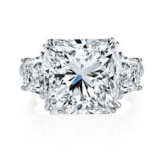 Radiant cut diamond engagement ring. Beautiful 8.13 radiant cut diamond flanked by diamond shields.  Call 216-464-6767 for more information.