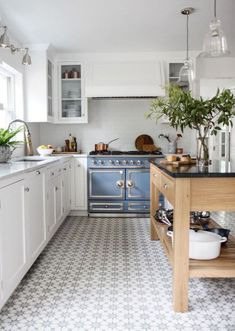 Reclaimed kitchen islands create a rich warm vibe. It's a beautiful trend and one to keep.