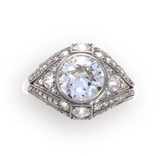 An art deco diamond ring, circa 1920  centering an old European-cut diamond within a bombé mount of old European, rose and single-cut diamonds; central diamond weighing approximately: 1.80 carats; mounted in platinum; size 7 3/4