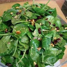 This Salad is the Business. Raspberry VInegrette is Amazing. Cranberry, Feta or blue cheese,  walnuts, Spinach salad w/Raspberry Vinegrette dressing (this you can buy from new world near the salads in little sachets at about $1.50 each