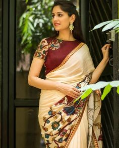 Cream Crepe Saree with handpainted kalamkari cross pallu applique border is paired with contrast maroon raw silk kalamkari blouse. This saree is from House of Blouse. Saree Blouse Neck Designs, Saree Blouse Patterns, Designer Blouse Patterns, Kalamkari Blouse Designs, Design Patterns, Trendy Sarees, Stylish Sarees, Simple Sarees, Designer Blouses Online