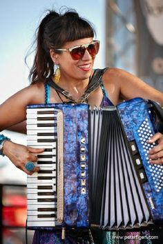 """Gee """"Gigi"""" Rabe Though she was given the title L.A's Accordion Diva, it doesn't take long to see Rabe is much more than that. She's won plenty of national and international awards, has contributed music for television shows and Disney rides."""