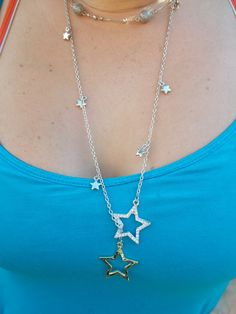 Everyone's a star with this long star necklace in silver tone.  Go to:  facebook.com/hotflairs  etsy.com/hotflairs
