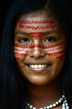 This lovely young woman is a member of a tribe that lives along The Amazon River in Brazil. The Amazon in Brazil has many small tribes that remain fairly traditional to this day. Their lovely spirit, dance, costumes, and culture are a delight to witness and to express in a photograph.