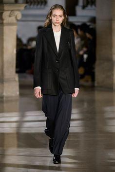 30. Long jacket in wool melton, short sweater in shetland wool, large pants in high density wool gabardine, heeled oxford in leather