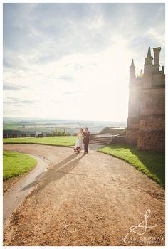 Bolsover Castle Wedding   Georgina and Gideon Bride and Groom backlit in the evening sun