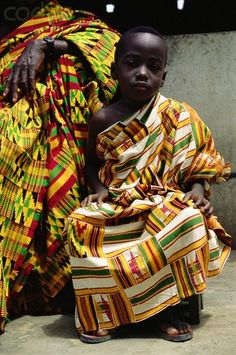 Ghana |  Chief of Bonwire's grandson, wearing a 50 year old kente cloth robe | Image and caption © Margret Courtney - Clark