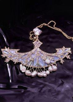 Georges Fouquet - An Art Nouveau gold, enamel, diamond and pearl brooch/pendant, 1900-1910. 8.6 x 10.9cm.