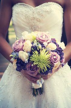 We love the colors in this bouquet!! Photo by Sarah M. #MinneapolisWeddingFlorists #WeddingFlowers #bridalbouquet
