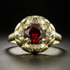 A textured, diamond dotted yellow gold flower blossoms in the center with a carat dusky red faceted round garnet in this distinctively lovely estate jewel. The ribbed ring shank is currently size 6 Garnet And Diamond Ring, Black Diamond Jewelry, Garnet Jewelry, Wedding Rings Vintage, Vintage Engagement Rings, Victorian Jewelry, Antique Jewelry, Modern Jewelry, Fine Jewelry
