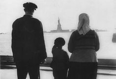 The Statue of Liberty, viewed from Ellis Island, by a small boy and his parents, ca. 1930. (Library of Congress)