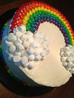 rainbow cake. the rainbow cake is topped with i think skittles and tons of marshmallows. this cake would be good for a birthday party i guess!