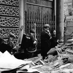Early August 1944, Warsaw. Insurgents armed with flame throwers. Moniuszki Street.  Source: Wikimedia Commons, Photo by Eugeniusz Lokajski