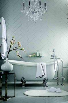 Elegant bathroom with roll top bath by Clearwater.
