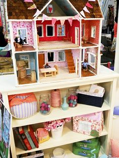 Sarah Janes booth at Quilt Market. Love the doll house lined with fabric on the walls