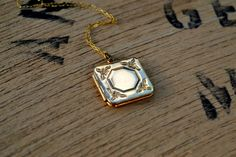 square locket necklace with octagon center/ shiny by RefugeHeart