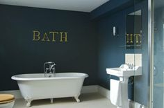A classic bathroom like they used to be. The paint on the wall is Hague Blue by Farrow.