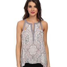 """BCBGMAXAZRIA Top Pink clay combo. Draped sides and fluttery movement to a pretty printed tank . Shoulder cutout with trim. Back keyhole. Sharkbite hem about 27"""" from shoulder to hem . Unique and classy top . Purchased at saks. New with tags BCBGMaxAzria Tops"""