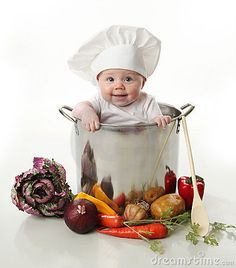 Photo about Portrait of a smiling baby sitting inside a large cooking stock pot surrounded by vegetables and food, isolated on white. Image of cute, ingredients, baby - 17727343