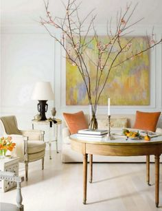 Beautiful!  The styling  is stunning with the branch, pillows and the art- Yum!   Interior design by my friend, Frank Babb Randolph of DC