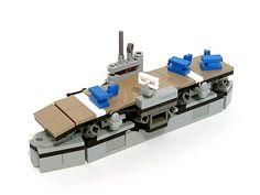 It has little blue biplanes. And dark tan is still awesome. Lego Plane, Lego Boat, Lego Ww2, Lego Army, Micro Lego, Lego Ship, Lego System, Lego Store, Lego Mecha
