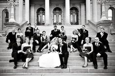 like this bridal party picture with everyone sitting on the steps