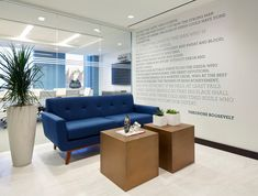 B2R reception area in NYC with blue sofa brass table