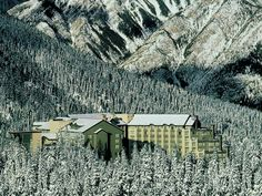 the rimrock resort hotel is nestled into a snowy valley #travel
