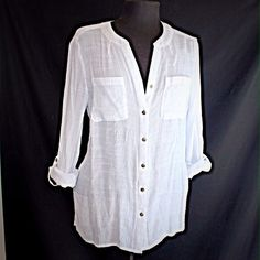EUC Semi-Sheer White Button Down Gently used semi-sheer white button down shirt with silver embellishment around the neck. Sleeves roll up and button at 3/4 length. Tops Button Down Shirts