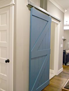 sliding barn door to mud room DIY Blogger House at Daybreak by Bangerter Homes www.daybreakutah.com @daybreakut
