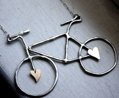 This bold bicycle necklace is the perfect statement making accessory. It's handmade by me out of sterling silver, with two little hand cut brass hearts soldered to the spokes. The bike hangs on an 18 in sterling silver chain! It's polished to a bright and shiny satin finish, and will be your new favorite necklace.