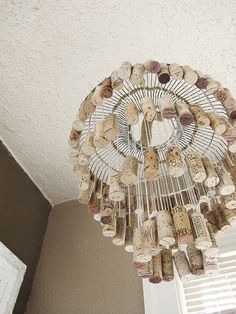diy wine cork chandelier.  i'd have to reimagine this a little to make it practical but i like the idea and it doesn't look difficult.